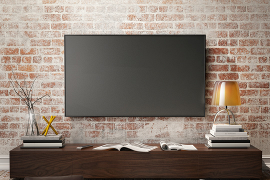 Fernseher an Wand aus Steinoptik