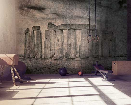 Loft style gym with old brick wall with sports equipment